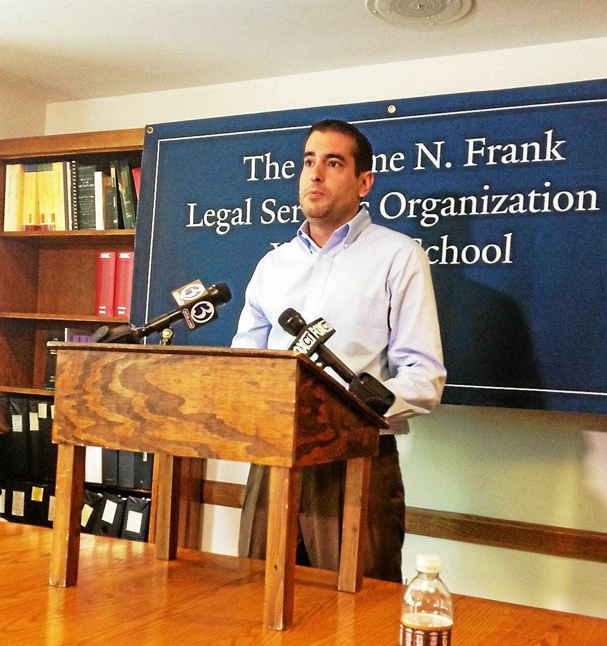 Salvador Milardo, son of Paolina Milardo, becomes emotional as he talks about his mother's deportation at a press conference at the Yale Law School in New Haven.