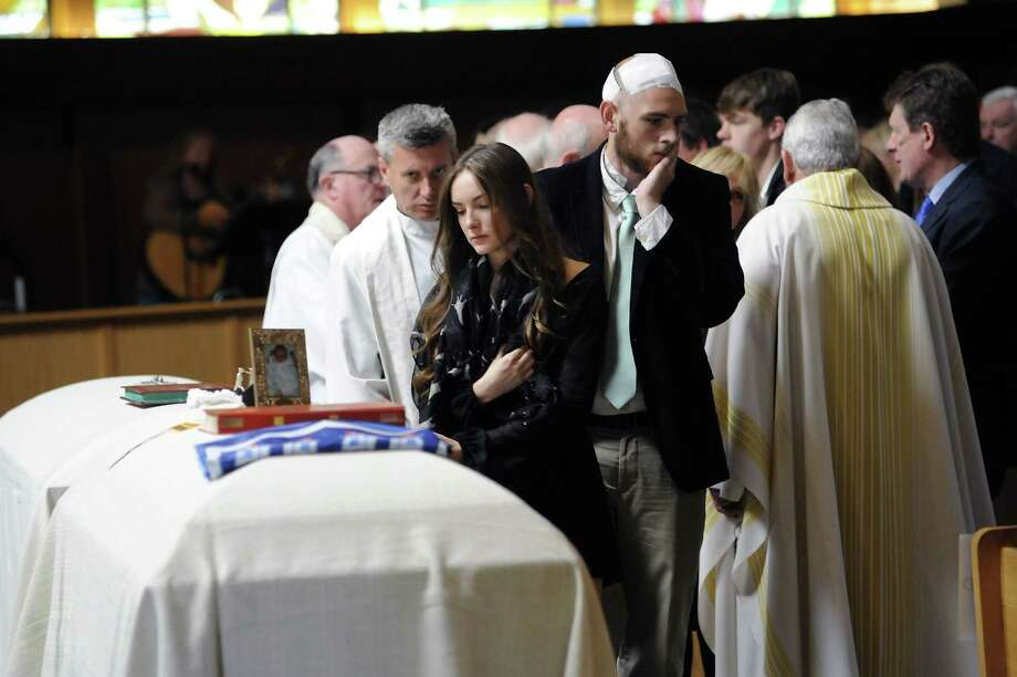 Ashley Donohoe looks at her sister's casket during a service for Olivia Burke, 21, and Ashley Donohoe, 22, at St. Joseph Catholic Church in Cotati, Calif., on Saturday, June 20, 2015.  The two woman were among the several people killed on Tuesday when a balcony snapped off the fifth floor of a Berkeley apartment building during a birthday party. Photo: (AP Photo/Michael Short) / FR27929 AP