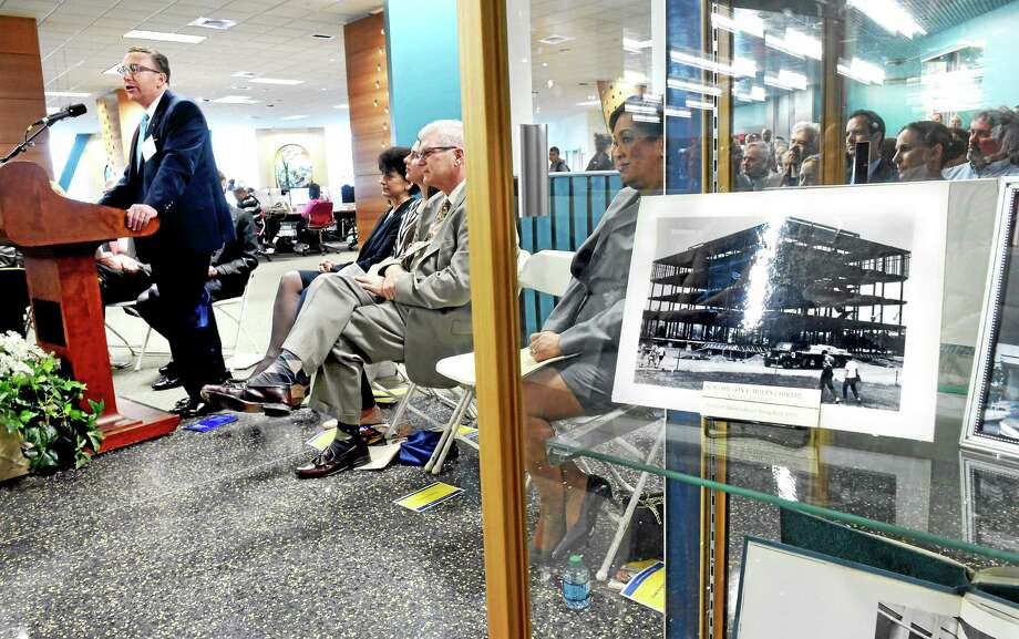 (Arnold Gold-New Haven Register)  James Buley (left), grandson of former Southern Connecticut State University president Hilton C. Buley, speaks during the Ribbon-Cutting Ceremony for the renovation and addition to the Hilton C. Buley Library at Southern Connecticut State University in New Haven on 4/20/2015.  At right is a photo of library under construction in 1969. Photo: Journal Register Co.
