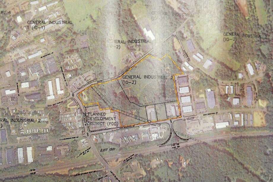 An overhead printout of the proposed area in Branford where wholesale giant Costco (highlighted in yellow) is hoping to build a 158,000-square-foot facility near Exit 56. Photo: Esteban L. Hernandez — New Haven Register