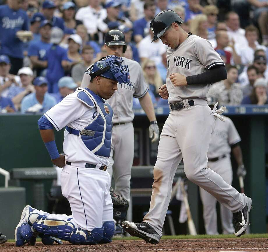The New York Yankees' Jacoby Ellsbury scores past Royals catcher Salvador Perez during Saturday's game in Kansas City, Mo. Photo: Charlie Riedel — The Associated Press   / AP