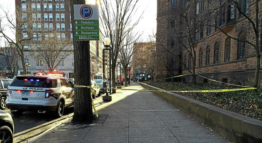 Police blocked off a large section of sidewalk along College Street outside of Bingham Hall at Yale after a student fell from a fourth floor window. The student was taken to Yale-New Haven Hospital. Photo: (Wes Duplantier -- New Haven Register)