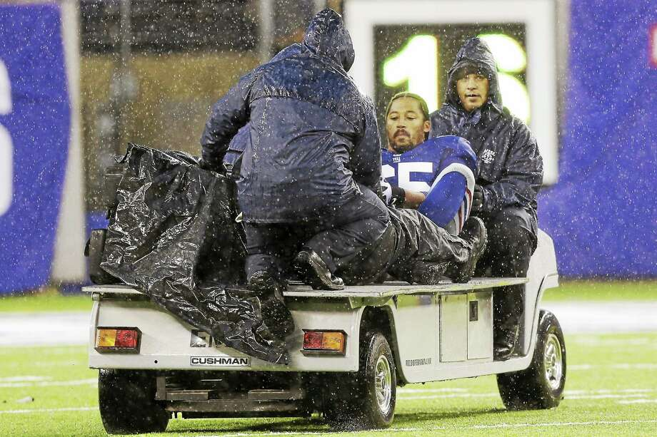 New York Giants left tackle Will Beatty is carted off the field on Dec. 29, 2013. Photo: Julio Cortez — The Associated Press File Photo   / AP