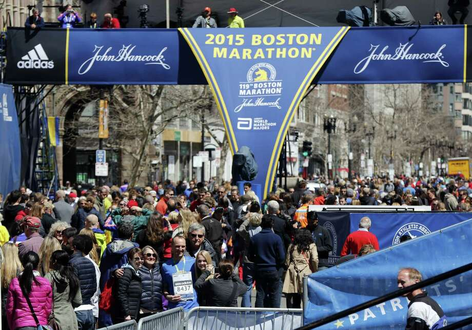 Runners and spectators crowd the finish line on Boylston Street on Sunday. Photo: The Associated Press   / AP