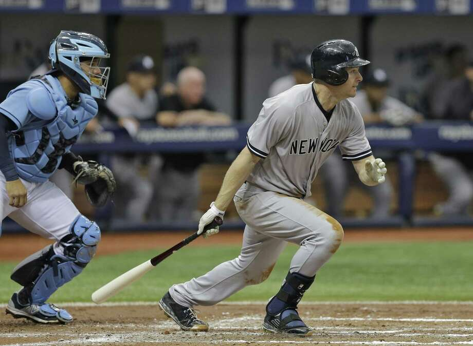 Chase Headley watches his RBI single in the third inning against the Rays on Sunday. Photo: The Associated Press   / AP
