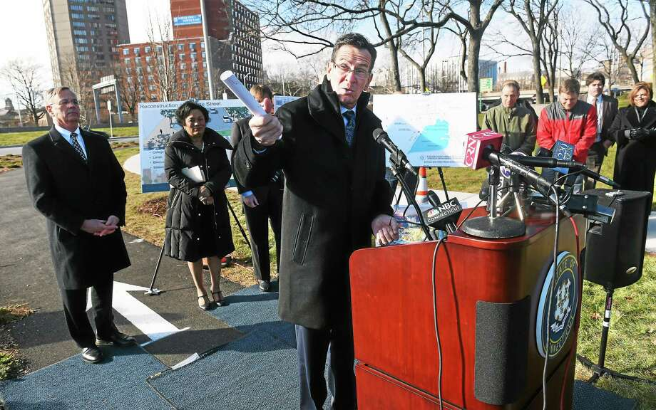 Governor Dannel Malloy (center) talks about the transportation budget during a press conference at the intersection of Rt. 34 and Orange St. in New Haven on January 20, 2015. Photo: (Arnold Gold — New Haven Register)