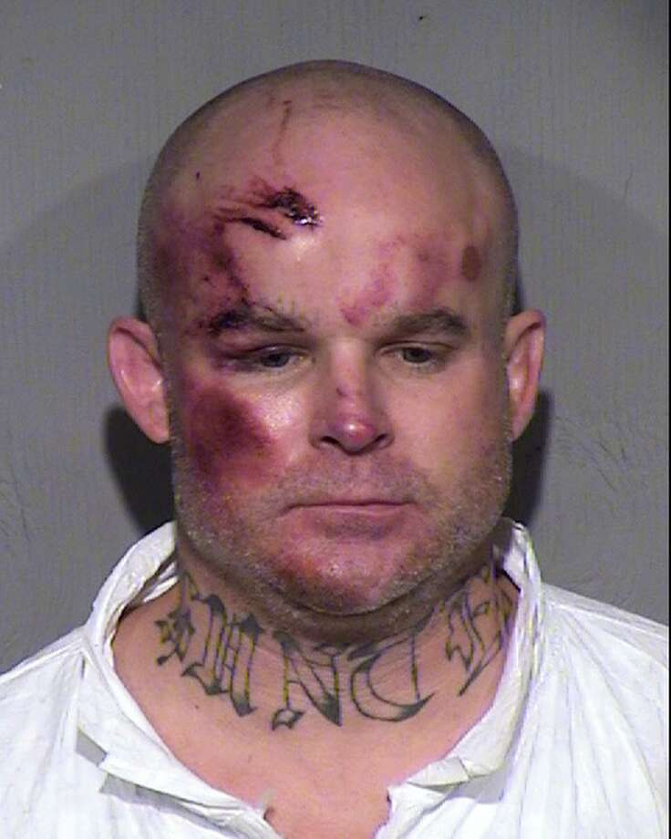 This undated booking photo provided by the Maricopa County Sheriff's Office shows Ryan Giroux, 41, who Mesa police say committed a string of crimes that included a motel shooting, a carjacking and a home invasion that ended with the suspect's arrest on Wednesday, March 18, 2015.  Police said the motive for the initial shooting at the motel was unclear but the other three shootings appeared motivated by robbery and the suspect's attempt to flee.  (AP Photo/Maricopa County Sheriff's Office) Photo: AP / Maricopa County Sheriff