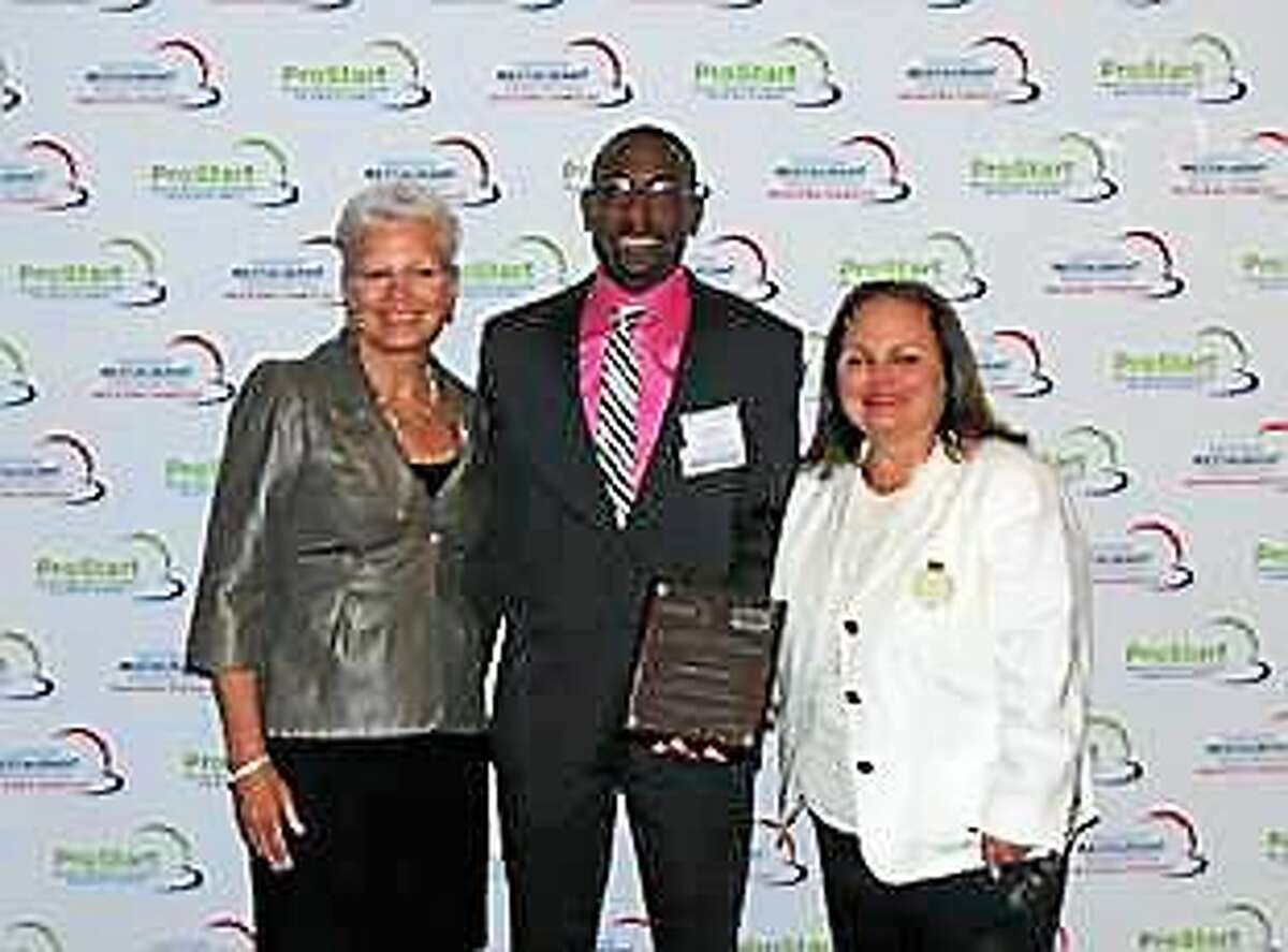 Nathanial Bradshaw, center; Lorna Donatone, president/COO, Education Market, Sodexho, and vice chairwoman of the NRAEF, left; and Judy Irwin of Golden Corral, right.