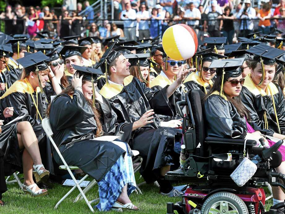 Nick O'Brien hits a beach ball during graduation ceremonies for Amity Regional High School in Woodbridge on 6/19/2015. Photo: (Arnold Gold-New Haven Register)