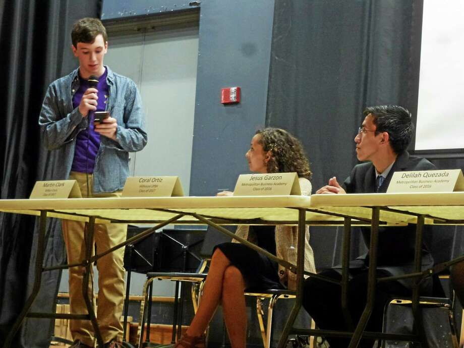 Martin Clark speaks as Coral Ortiz and Jesus Garzon look on during a panel discussion on students running for the school board. Photo: Ryan Flynn — New Haven Register