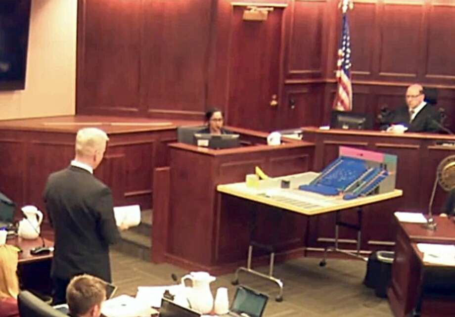 In this image made from a video, Gargi Datta, a former girlfriend of Colorado theater shooter James Holmes, is questioned by District Attorney George Brauchler , during a trail for Holmes, Wednesday, June 10, 2015, in Centennial, Colo. Datta said Wednesday that she met Holmes in 2011 and that they went to a horror film festival on their first date. Holmes pleaded not guilty by reason of insanity in the July 2012 shooting at a suburban Denver movie theater that killed 12 people and injured 70. (Colorado Judicial Department via AP, Pool) Photo: AP / Pool, Colorado Judicial Department