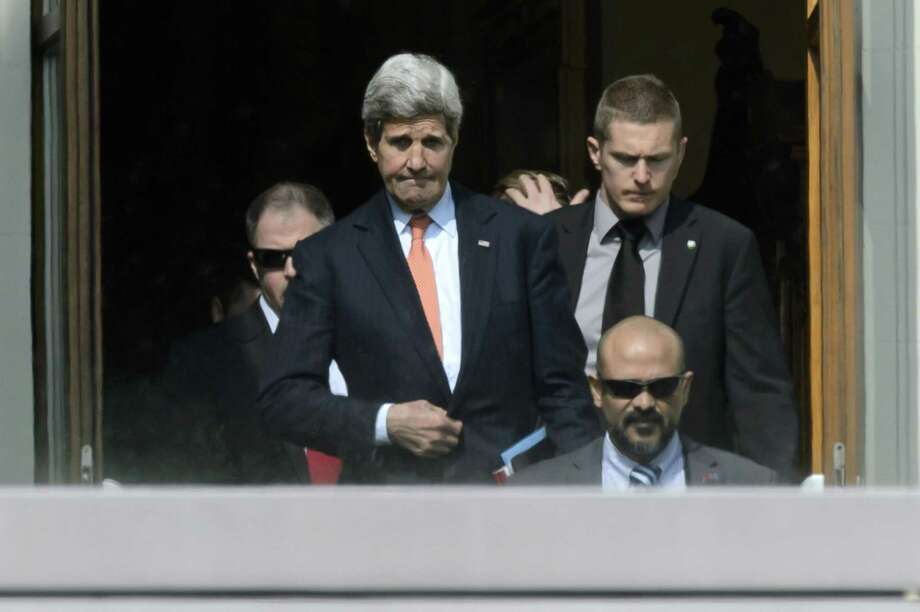 U.S. Secretary of State John Kerry, center, walks outside the hotel during a break from a bilateral meeting with Iranian Foreign Minister Mohammad Javad Zarif for a new round of Nuclear Talks, in Lausanne, Switzerland, Thursday, March 19, 2015.  (AP Photo/Keystone,Laurent Gillieron) Photo: AP / KEYSTONE