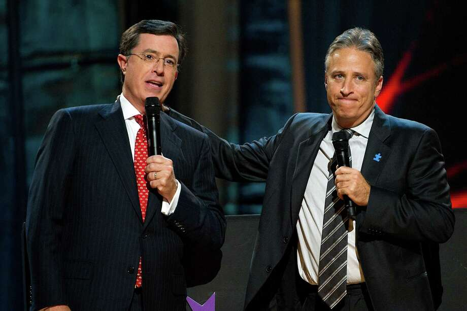 Stephen Colbert, left, and Jon Stewart in 2010. Photo: THE ASSOCIATED PRESS   / SYKEC