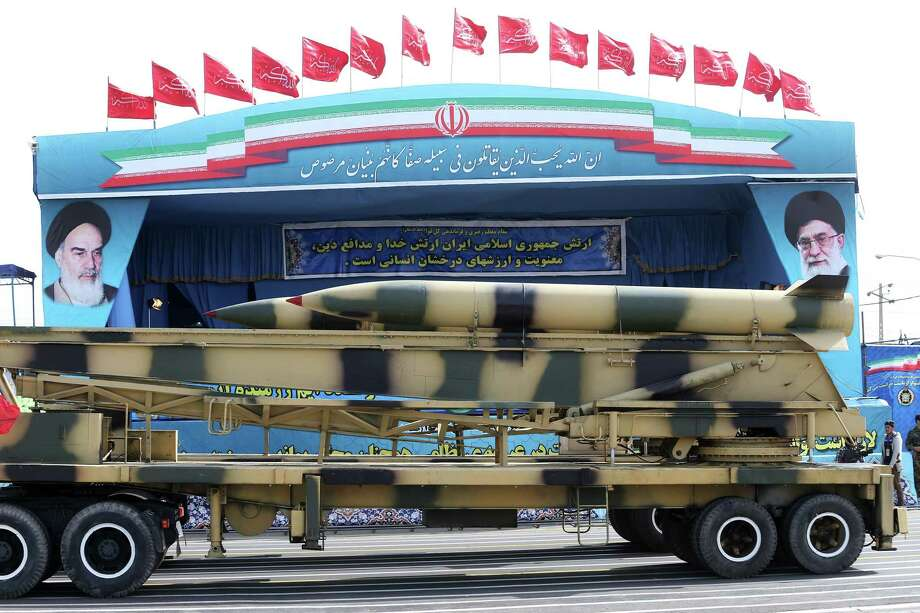 Missiles are displayed by the Iranian army in a military parade marking National Army Day in front of the mausoleum of the late revolutionary founder Ayatollah Khomeini, just outside Tehran, Iran, Saturday, April 18, 2015. Iranian President Hassan Rouhani  harshly criticized Saudi Arabia Saturday, warning that the Saudi royal family in Riyadh will harvest the hatred it is sowing in Yemen through its airstrike campaign. (AP Photo/Ebrahim Noroozi) Photo: AP / AP