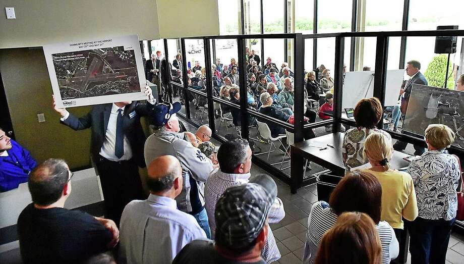 The crowd overflowed Wednesday during a community meeting at Tweed New Haven Regional Airport. Photo: Catherine Avalone — New Haven Register   / New Haven RegisterThe Middletown Press