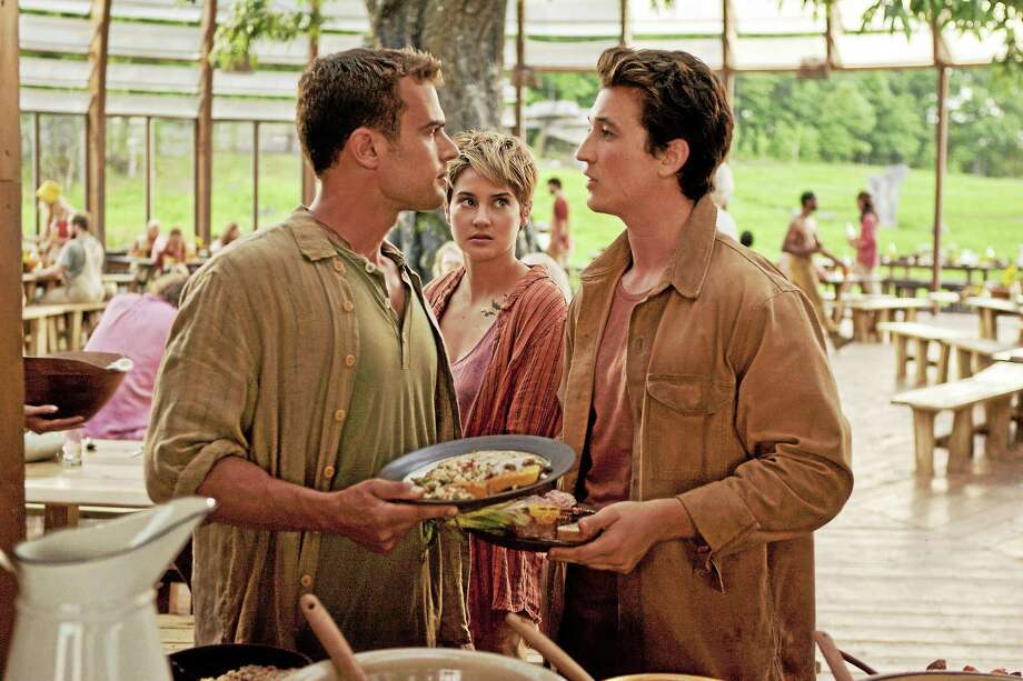 "Theo James, left, Shailene Woodley and Miles Teller in ""The Divergent Series: Insurgent."" Photo: Andrew Cooper  - Lionsgate   / Lionsgate"
