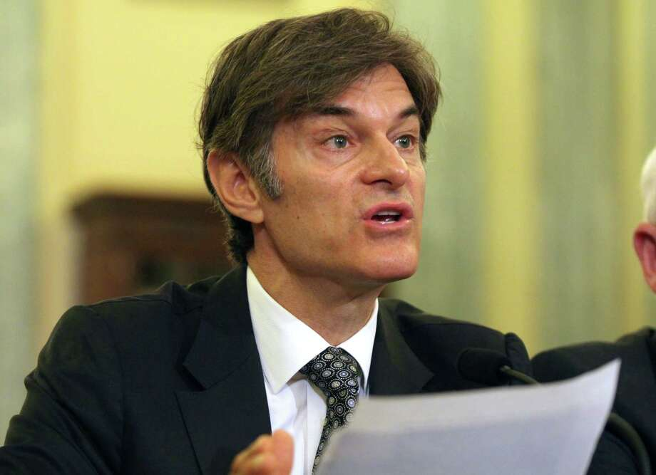 """FILE - In this June 17, 2014, file photo, Dr. Mehmet Oz, vice chairman and professor of surgery, Columbia University College of Physicians and Surgeons, testifies on Capitol Hill in Washington. Ten top physicians want Columbia University to remove the celebrity doctor from his medical faculty position. They cite what they call the heart surgeon's """"egregious lack of integrity"""" as host of a television program where he promotes weight loss products. (AP Photo/Lauren Victoria Burke, File) Photo: AP / FR132934 AP"""