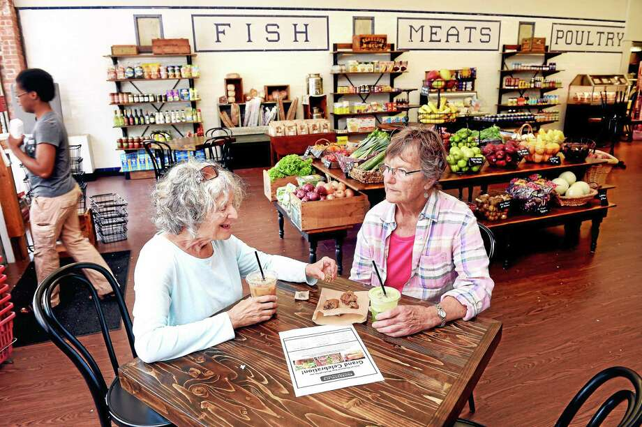 Betsy Sterzel (left) and Gwen Fletcher (right) of Guilford sit down to cold drinks at The Marketplace at Guilford Food Center at 77 Whitfield St. in Guilford on 5/18/2015. Photo: (Arnold Gold-New Haven Register)