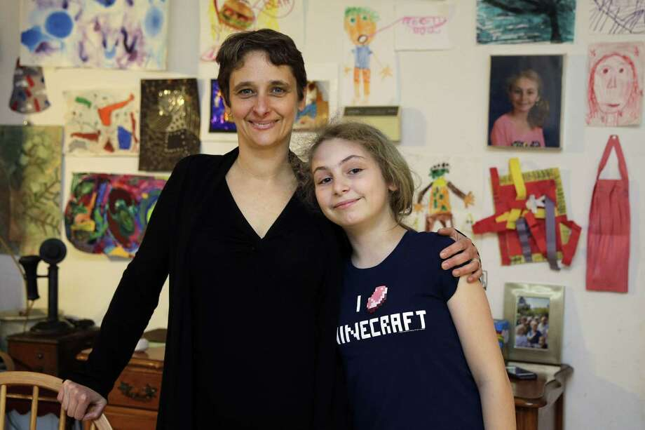 In this Thursday, April 16, 2015 photo, Meredith Barber poses with her daughter Gabrielle Schwager, 10, at their home in Penn Valley, Pa. Barber, a psychologist from the Philadelphia suburb of Penn Valley, has decided Gabrielle will not be taking the Pennsylvania System of School Assessment this year and has been encouraging other parents to opt out. (AP Photo/Matt Slocum) Photo: AP / AP