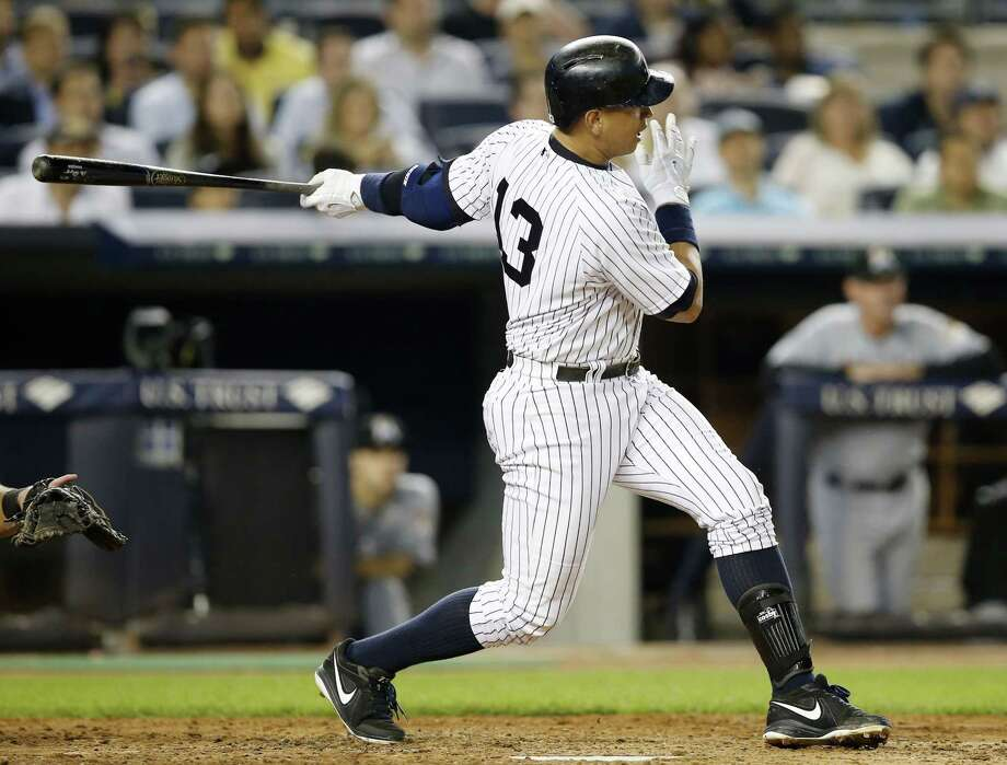 Yankees designated hitter Alex Rodriguez follows through on his 2,999th career hit in the fifth inning against the Miami Marlins Thursday. Photo: Kathy Willens — The Associated Press   / AP