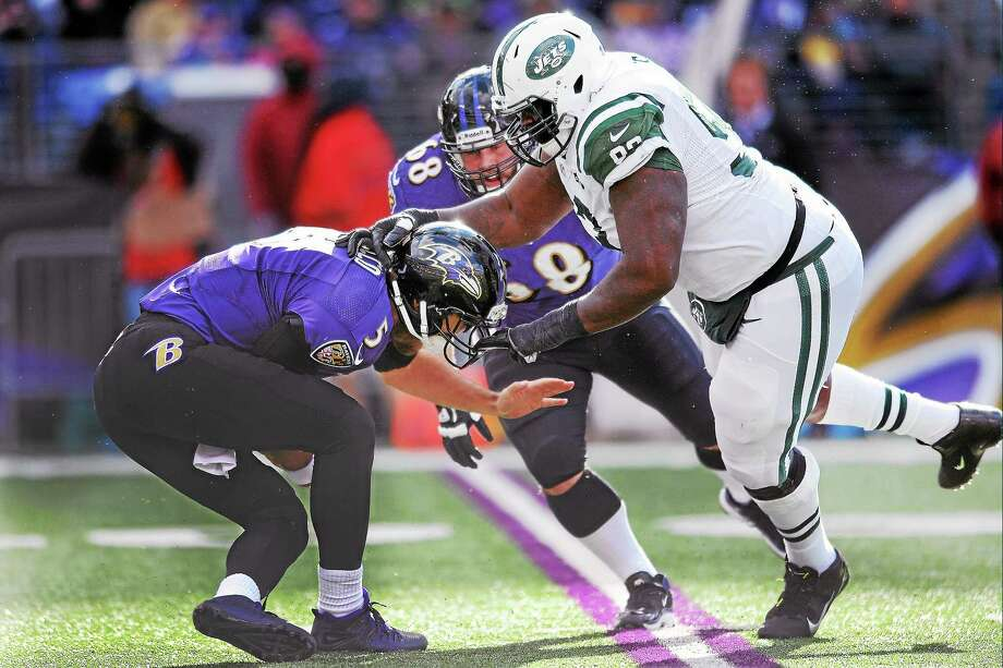 Baltimore Ravens quarterback Joe Flacco is sacked by New York Jets defensive end Kenrick Ellis during a 2013 game. Photo: Gail Burton — The Associated Press File Photo   / AP2013