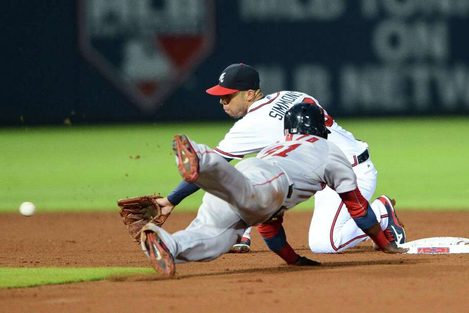 Red Sox left fielder Alejandro De Aza (31) steals second base as Atlanta Braves shortstop Andrelton Simmons reaches for the ball. Photo: Jon Barash — The Associated Press   / FR171294 AP