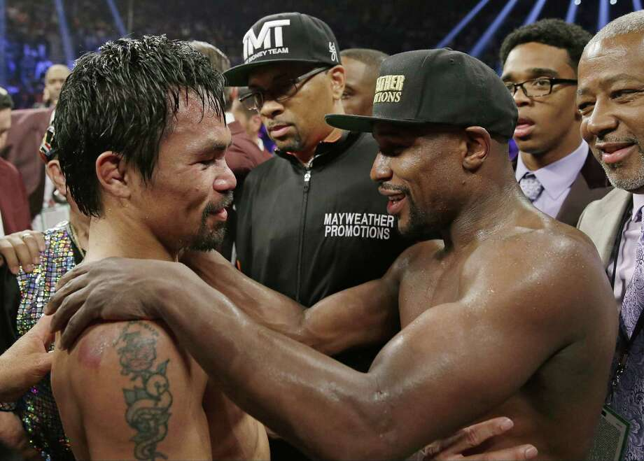 Boxing fans across the country, or at least their lawyers, are calling the hyped-up fight between Manny Pacquiao and Floyd Mayweather a fraud. Some 31 class action lawsuits had been filed alleging primarily the same thing: that Pacquiao's pre-existing shoulder injury should have been disclosed to fans ahead of time. Photo: Isaac Brekken — The Associated Press File Photo   / FR159466 AP
