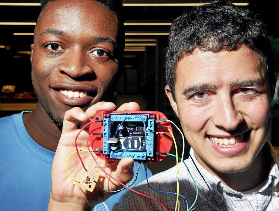 Tayo Ajayi (left) and Gordon McCambridge are photographed with a monitoring device they created that is designed to be self programmed with any type of sensor and can connect to a home computer in the Yale Center for Engineering Innovation and Design. Photo: Arnold Gold--New Haven Register