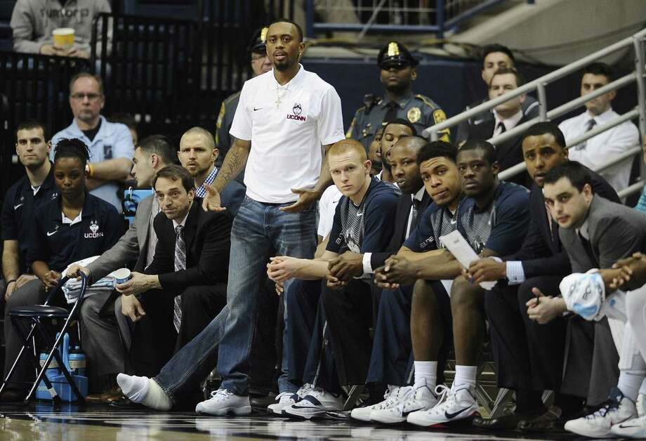 UConn's Ryan Boatright watches play from the Connecticut bench in the first half of a game against Arizona State in the first round of the NIT. Photo: Jessica Hill — The Associated Press   / FR125654 AP