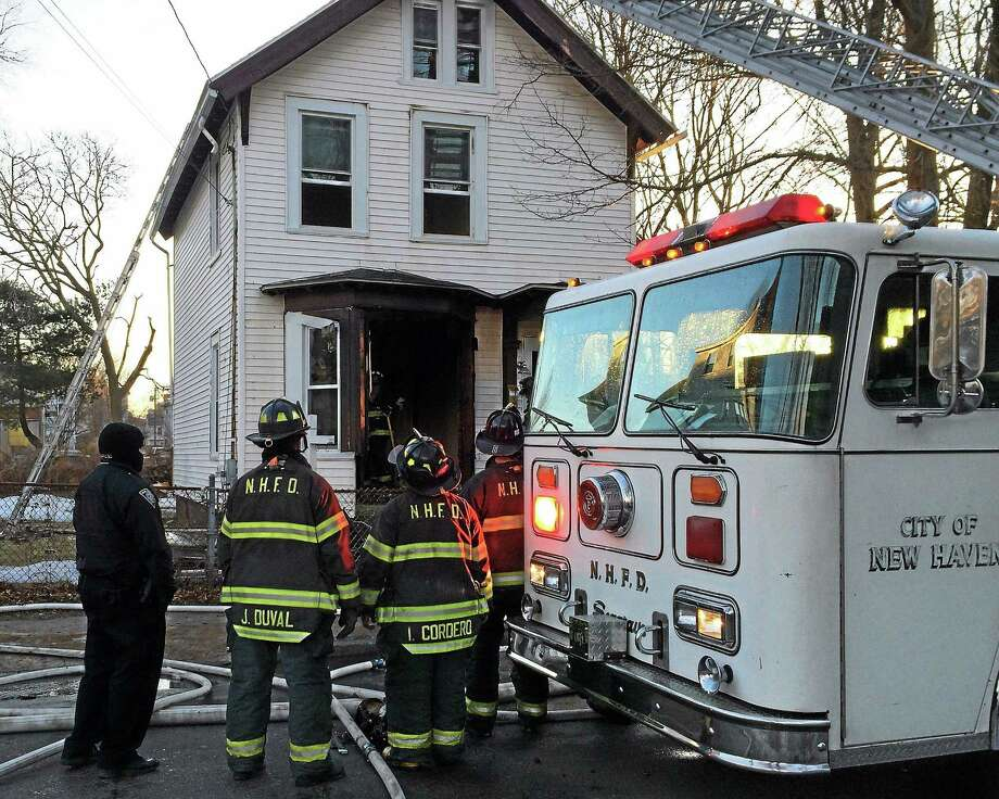 Firefighters battled a fire on the first floor of a vacant home at 131 West St. in New Haven early Wednesday. No one was inside the home and the cause of the fire remained under investigation. Photo: (Wes Duplantier -- New Haven Register)