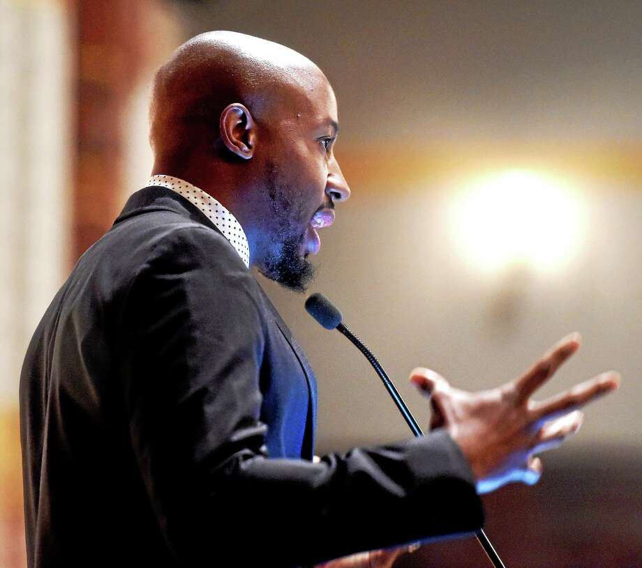 Pastor Carlton Lee of Flood Christian Church in Ferguson, Missouri, delivers the keynote address at the Let Us Break Bread Together program at Yale University's Battell Chapel Monday in New Haven. Photo: Arnold Gold — New Haven Register