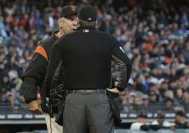 San Francisco Giants manager Bruce Bochy, left, argues with umpire Chris Conroy after Pittsburgh Pirates' Andrew McCutchen's three-run home run during the second inning of a baseball game in San Francisco, Monday, July 24, 2017. (AP Photo/Jeff Chiu)