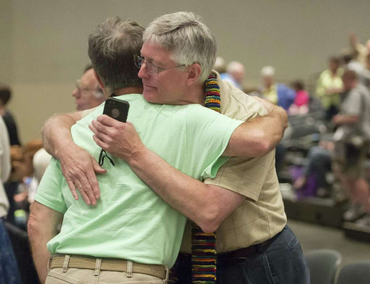 In this June 19, 2014 photo, Gary Lyon, left, of Leechburg, Pa., and Bill Samford, of Hawley, Pa., celebrate after a vote allowing Presbyterian pastors discretion in marrying same-sex couples at the 221st General Assembly of the Presbyterian Church at Cobo Hall, in Detroit.