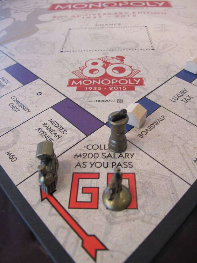 This March 11, 2015 photo shows a Monopoly board in Atlantic City, N.J. - the city on whose real-life streets the Monopoly board game is based. The board game turns 80 years old on Thursday, March 19, 2015. Photo: AP Photo/Wayne Parry   / AP