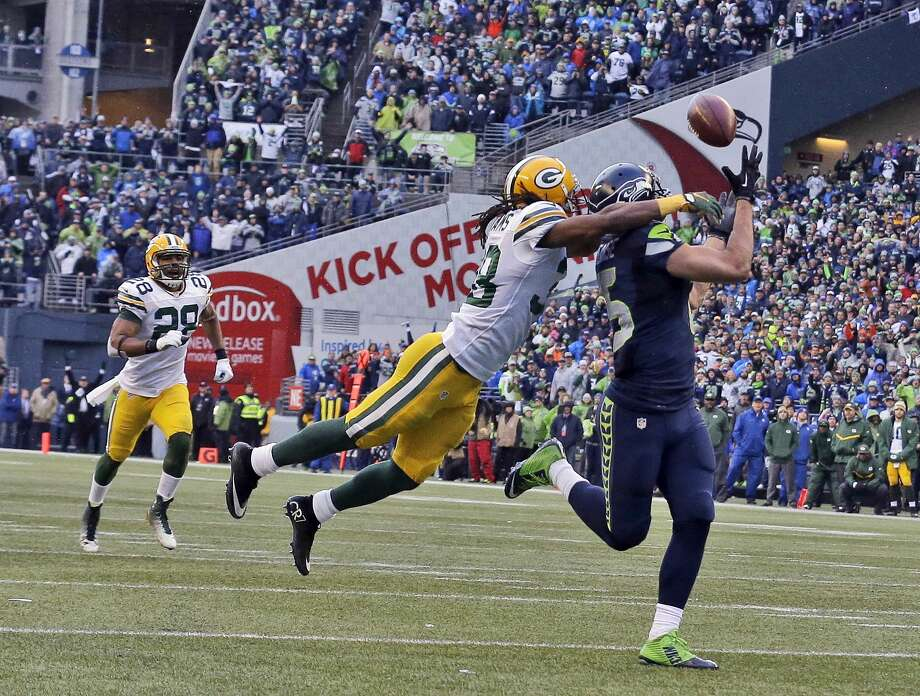 The Seahawks' Jermaine Kearse catches the game-winning touchdown pass during overtime against the Packers on Sunday. Photo: Jeff Chiu — The Associated Press   / AP