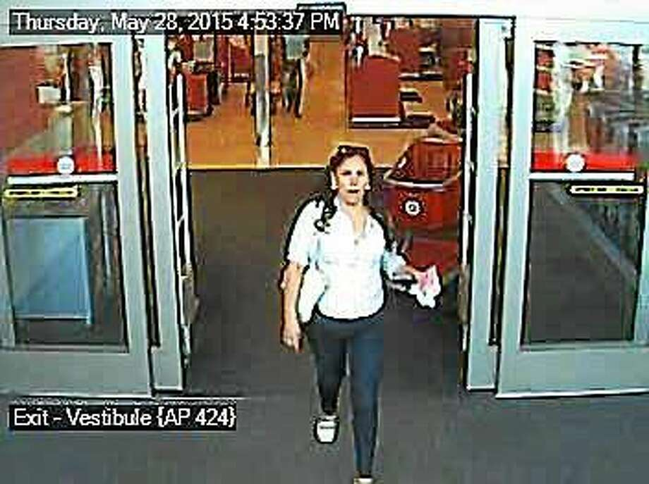 Police are looking for this woman, who they say purchased more than $9,000 worth of goods with a stolen credit card. Photo: North Haven Police Department