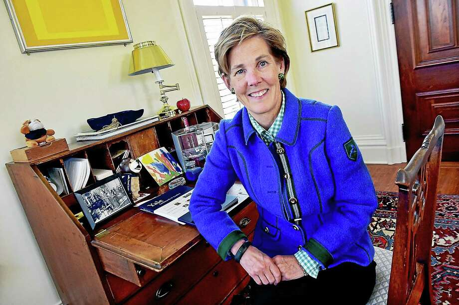 """Vice President of Yale University, Linda Lorimer, sits at her desk which once belonged to Angelo Bartlett """"Bart"""" Giamatti, president of Yale University and the seventh Commissioner of Major League Baseball. Lorimer is semi-retiring and will move to a part-time position. Photo: (Catherine Avalone - New Haven Register) / New Haven RegisterThe Middletown Press"""