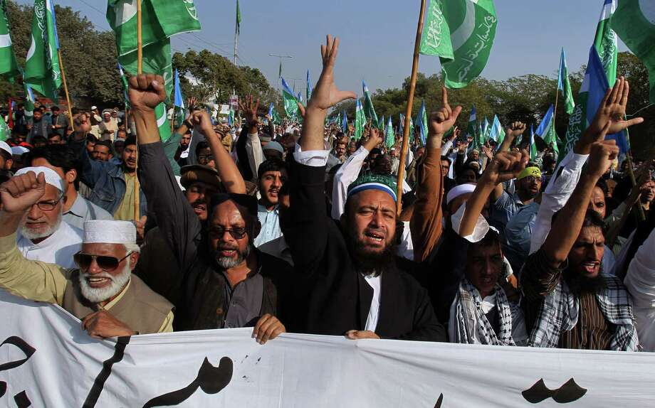 Supporters of the religious group Jamaat-e-Islami chant slogans during a demonstration against caricatures published in the French magazine Charlie Hebdo, in Karachi, Pakistan, Sunday, Jan. 18, 2015. (AP Photo/Fareed Khan) Photo: AP / AP