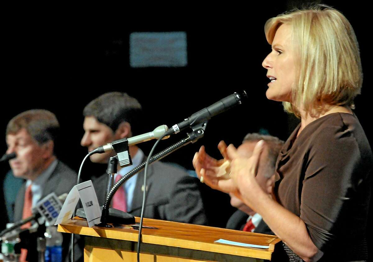 Fifth District congressional candidate Lisa Wilson-Foley addresses a question at Monday night's Republican debate at Brookfield High School. In the background, from left, are candidates Andrew Roraback, Justin Bernier and Mark Greenberg.