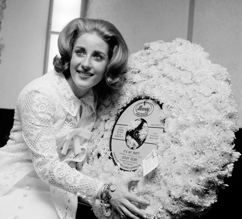 In this May 5, 1964 file photo, singer Lesley Gore hugs a flowered record at her 18th birthday party celebrated at the Delmonico Hotel in New York. Photo: Associated Press   / AP