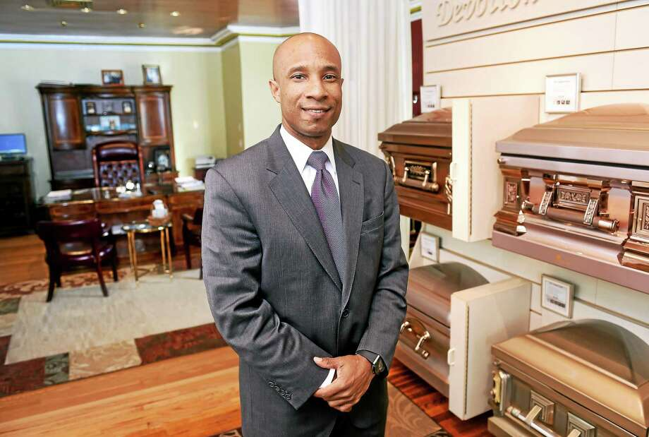 Howard K. Hill, owner of Howard K. Hill Funeral Services, is photographed in his New Haven showroom/office on 1/8/2015. Photo: (Arnold Gold-New Haven Register)