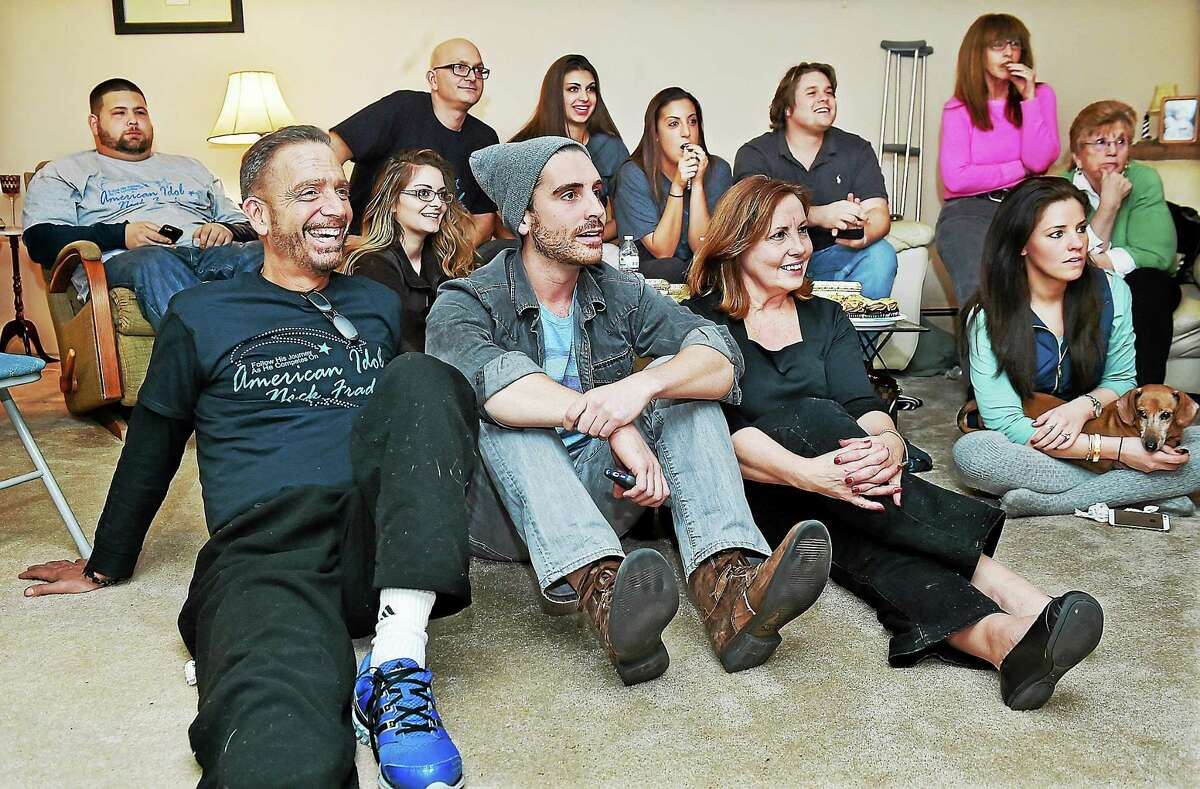 """Nick Fradiani, IV with his parents, Elizabeth and Nick Fradiani, III and family watch the airing of American Idol in their Guilford home, Thursday, January 15, 2015. Fradiani, 28, auditioned in New York City in October and sang """"In Your Eyes"""" by Peter Gabriel. Fradiani got a """"yes"""" from all three judges, Adam Lambert, Jennifer Lopez and Harry Connick Jr. and moves on to """"Hollywood Week,"""" which broadcasts starting Wednesday, February 4."""