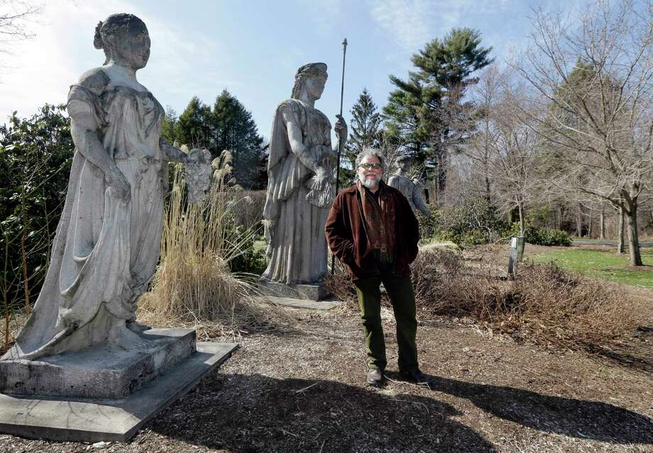 John Forti, horticultural director for the Massachusetts Horticultural Society, stands in the Goddess Garden at Elm Bank in Wellesley, Mass., Thursday, April 16, 2015. The barrage of snow and cold in New England this winter has pushed back the gardening season and left behind damaged bushes, trees and greenhouses and gardeners eager to get outside and in the dirt. Forti says the weight of the snow broke tree limbs and crushed shrubs as it fell off roofs. But the good news is that the water table is up significantly, which will help plants recovering from the tough winter. Photo: AP Photo/Elise Amendola   / AP