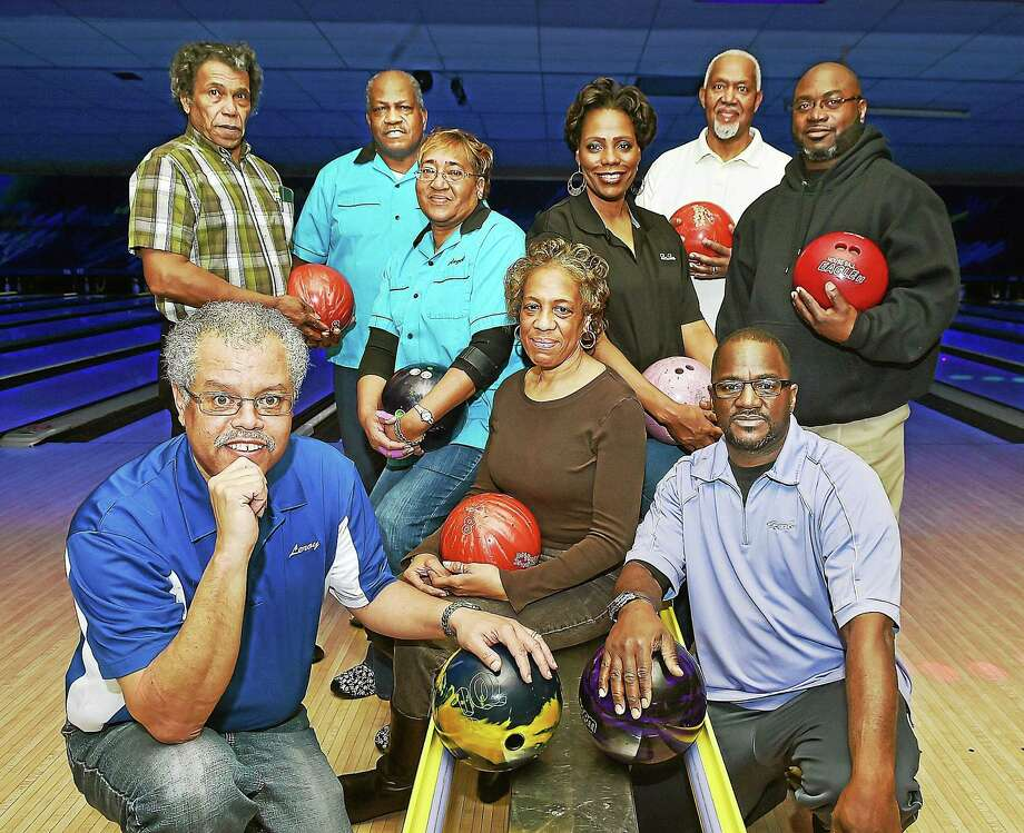 Men in back row, from left, Barry Diggs, Barbara Fox Classic Bowling League 35-year founding member; Mack Jones, 35-year founding member and The National Bowling Association Elm City Senate president; Ed Hines, The National Bowling Association Elm City Senate vice president; Sean Leak, Barbara Fox Sargeant at Arms. Women in center, clockwise from left: Angel Diggs, Barbara Fox 35-year founding member; Loretta Bellamy, Barbara Fox league president; and Sheryl Ravenell, The National Bowling Association E;m City Senate secretary/treasurer. Men in front: Leroy Owens Jr., left, Barbara Fox league secretary/treasurer; and Herb Barrett, Barbara Fox league vice president. Photo: Catherine Avalone — New Haven Register    / New Haven RegisterThe Middletown Press