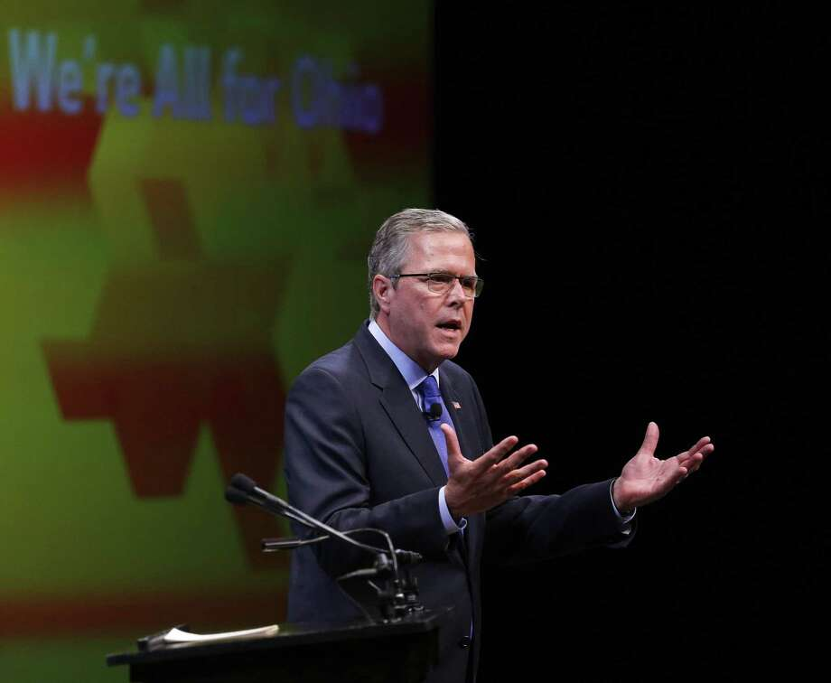 """Former Florida Gov. Jeb Bush delivers a speech during the annual meeting of the Ohio Chamber of Commerce, Tuesday, April 14, 2015, in Columbus, Ohio. The GOP White House prospect kicked off a speech in the battleground state with a series of personal recollections, saying he's his """"own person."""" Photo: Jonathan Quilter/The Columbus Dispatch Via AP    / The Columbus Dispatch"""