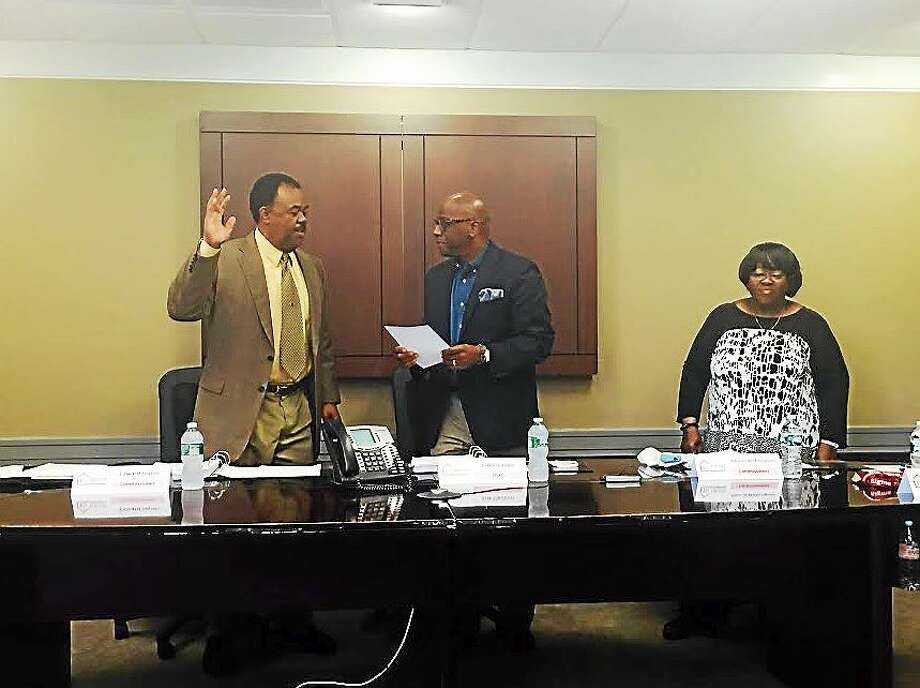 From left, Edward Joyner, Elm City Communities/HANH Chairman Erik Clemons and Commissioner Alberta Witherspoon. Photo: Contributed Photo