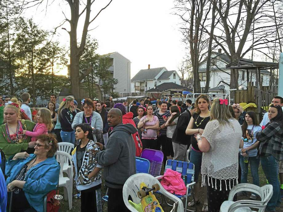 Several hundred gathered in the backyard of the home where Holly lived on Saturday evening. Friends, family and supporters from all over came to show support for the family. Photo: Photo By Mindy Hobson, The Register Citizen