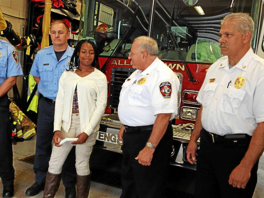 Aliyah Marie Graham, 14, with City of West Haven Fire Department Allingtown Chief Peter Massaro, center, Deputy Chief Michael Esposito and the paramedic and EMT who answered the call May 4 when she called 911 after coming across a 53-year-old man having a diabetic reaction. Photo: Mark Zaretsky — New Haven Register