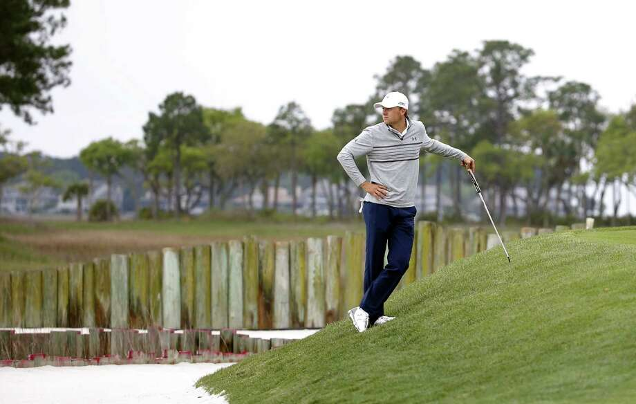 Jordan Spieth waits for his turn to putt on the 17th green during the second round of the RBC Heritage Friday in Hilton Head Island, S.C. Photo: Stephen B. Morton — The Associated Press   / FR56856 AP