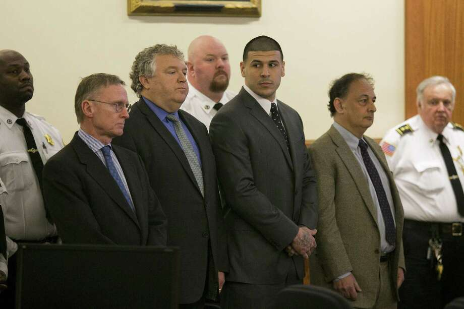 Former New England Patriot Aaron Hernandez, center, stands with his defense attorneys as the verdict is read in his murder trial on Wednesday at Bristol County Superior Court in Fall River, Mass. Hernandez was found guilty of first-degree murder. Photo: Dominick Reuter — The Associated Press   / Pool Reuters